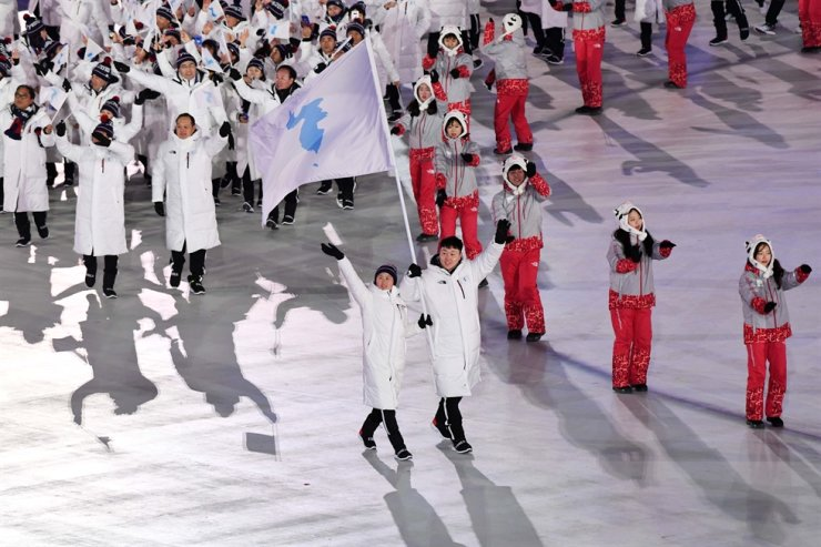 Athletes from both South and North Korea jointly enter the stadium under the Korea Unification flag during the opening ceremony of the PyeongChang Winter Olympic Games in Gangwon Province, in this Feb. 9, 2018 photo. Korea Times file