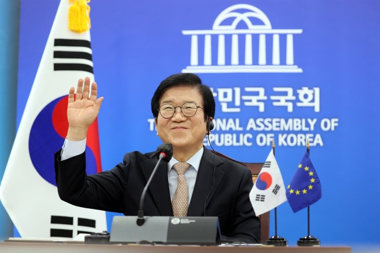 National Assembly Speaker Park Byeong-seug raises a hand and smiles during a video meeting with European Parliament President David Sassoli, Tuesday (KST). Courtesy of the office of National Assembly speaker
