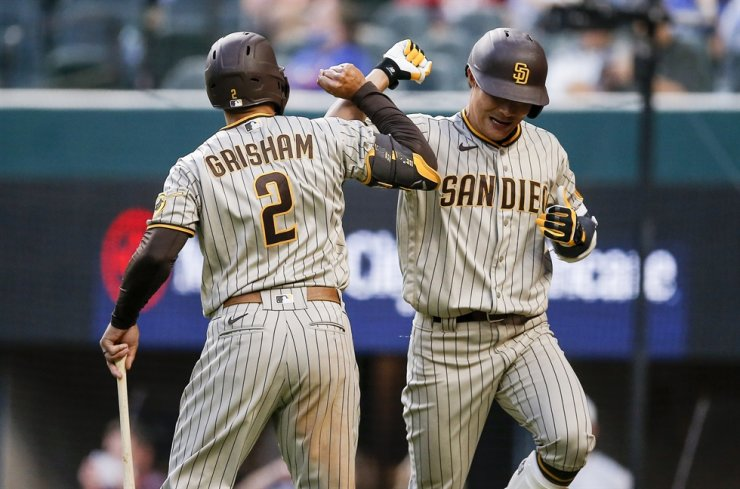 San Diego Padres' Kim Ha-seong, right, is congratulated by Trent Grisham after hitting a solo home run during the fifth inning of a baseball game against the Texas Rangers, Saturday, April 10, 2021, in Arlington, Texas. AP