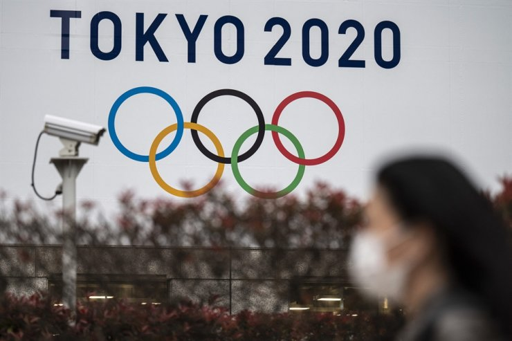 A Tokyo Olympics Games banner is displayed on the wall of the Tokyo Metropolitan Government building in Tokyo on April 13. AFP