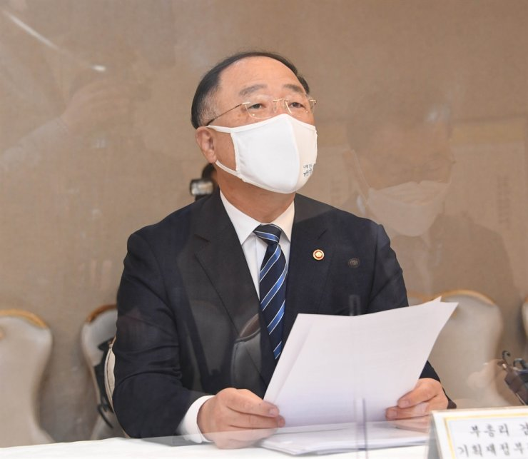 Finance Minister Hong Nam-ki speaks during a ministerial meeting to monitor the local real estate market, at the Government Complex in Seoul, Thursday. Courtesy of Ministry of Economy and Finance