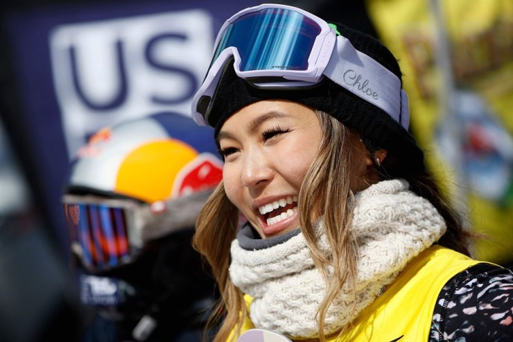 In this file photo taken on March 21, 2021, Chloe Kim of the United States reacts after winning the women's snowboard halfpipe finCl during Day 4 the Land Rover U.S. Grand Prix World Cup at Buttermilk Ski Resort in Aspen, Colorado. AFP-Yonhap