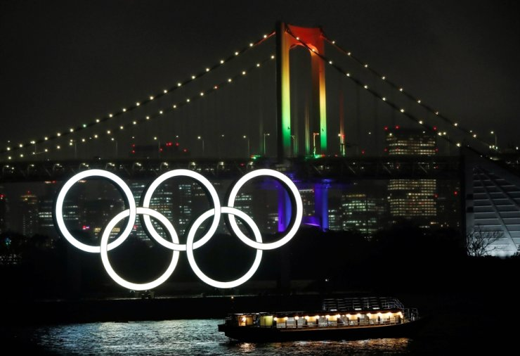 The Rainbow Bridge is illuminated with Olympic colors to mark 100 days countdown to the Tokyo 2020 Olympics that have been postponed to 2021 due to COVID-19 outbreak in Tokyo, April 14. Reuters