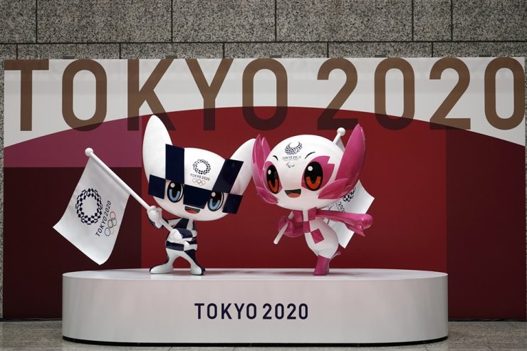 The statues of Miraitowa, left, and Someity, official mascots for the Tokyo Olympics and Paralympics, are seen to mark 100 days before the start of the Summer Games at the Tokyo Metropolitan Government building, April 14, in Tokyo. AP