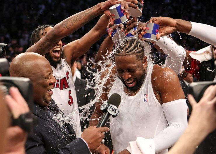 Ex-Miami Heat guard Dwyane Wade is doused with water from his teammates after playing his last NBA game against the Brooklyn Nets in April 2019. South China Morning Post