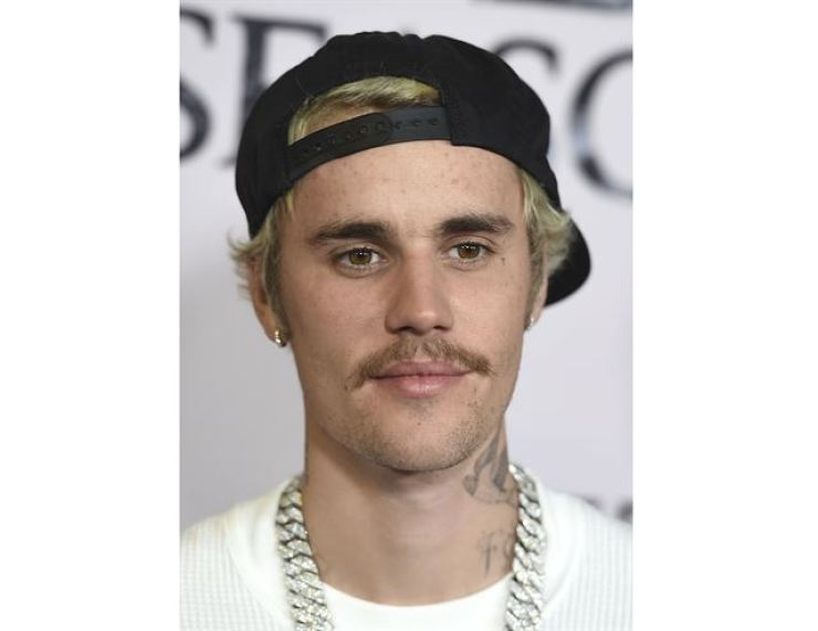 In this Jan. 27, 2020 file photo, Justin Bieber arrives at the Los Angeles premiere of 'Justin Bieber: Seasons.' AP