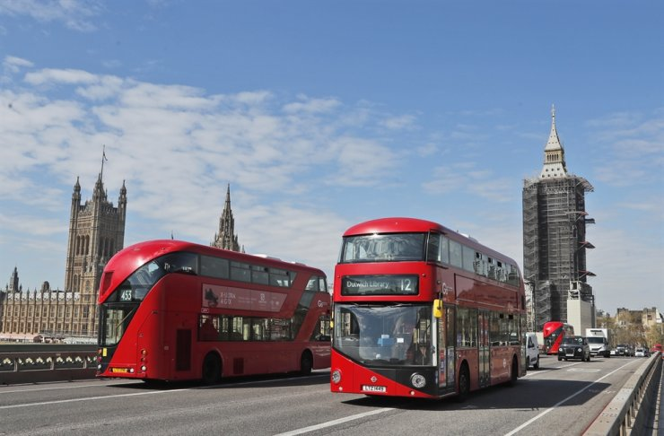 Elizabeth Tower which contains Big Ben stands, right, near Parliament Square in London, April 27. AP-Yonhap