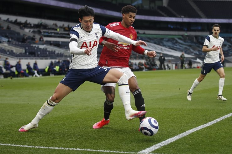 Tottenham's Son Heung-min, left, is challenged by Manchester United's Marcus Rashford during the English Premier League football match between Tottenham Hotspur and Manchester United at the Tottenham Hotspur Stadium in London, April 11. AP