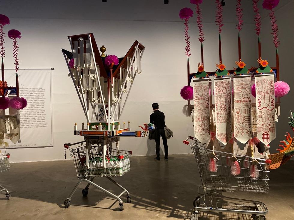 The 13th Gwangju Biennale exhibition shows Outi Pieski's 'Beavvit II/ Rising Together II,' left, and Min Joung-ki's landscape painting, 'Poetical Circles' Pavilions in Mudeung Mountain,' Buk-gu, Gwangju, April 1. Yonhap