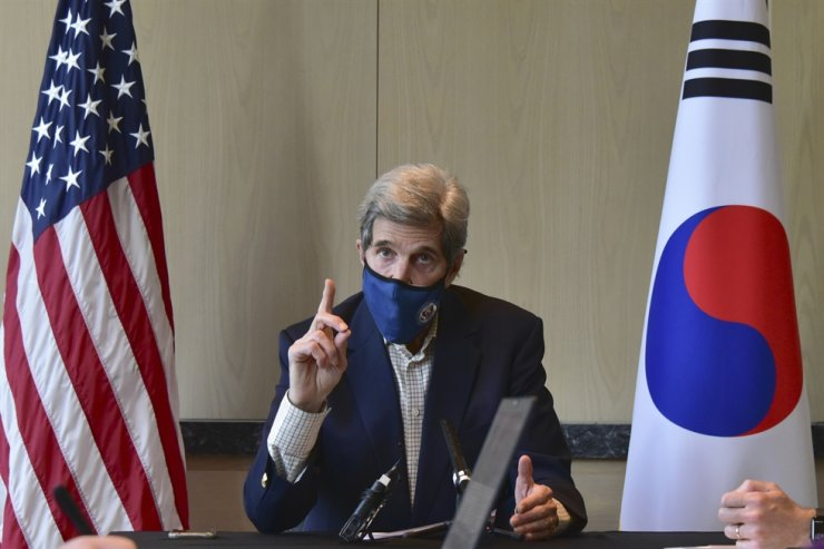 In this April 18 file photo provided by U.S. Embassy Seoul, U.S. special envoy for climate John Kerry speaks during a round table meeting with the media in Seoul. AP-Yonhap
