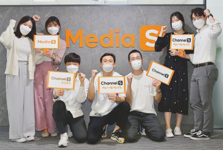 Media S employees pose marking the launch of the company's new TV channels, in this provided photo. Courtesy of SK Broadband