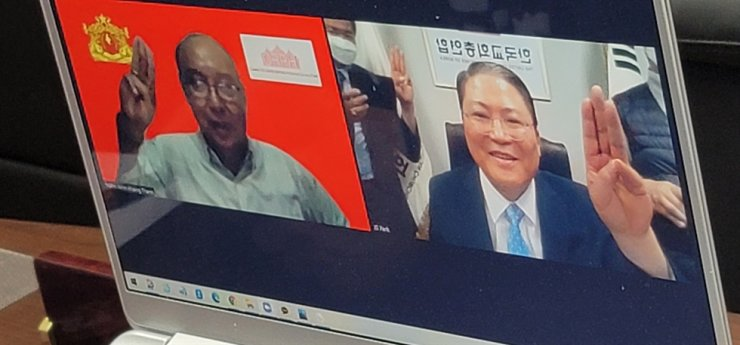 So Kang-suk, right, co-leader of the United Christian Churches of Korea (UCCK), one of the largest associations of Protestant churches in Korea, speaks during a video call with Mahn Win Khaing Than, the prime minister of the National Unity Government (NUG), newly formed government of Myanmar and opponents of the Myanmar's military coup, Wednesday. Courtesy of UCCK