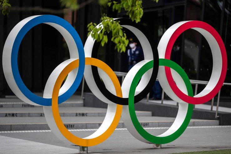 The Olympic Rings are pictured near the National Stadium, main venue for the Tokyo 2020 Olympic and Paralympic Games, in Tokyo on April 28. AFP-Yonhap