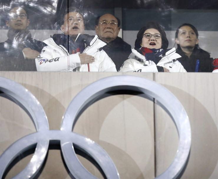 President Moon Jae-in, second from left, sings South Korea's national anthem during the opening ceremony of the 2018 PyeongChang Winter Olympic Games on Feb. 9, with the presence of Kim Yo-jong, right, North Korean leader Kim Jong-un's sister, and Kim Yong-nam, center, then the North's nominal head of state. AP-Yonhap