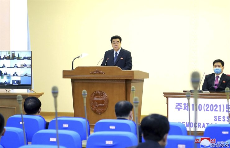 In this photo provided by the North Korean government, North Korean Sports Minister Kim Il-guk speaks during a national Olympic Committee meeting, March 25, during which North Korea decided not to participate in the Tokyo Olympics because of the coronavirus. AP-Yonhap