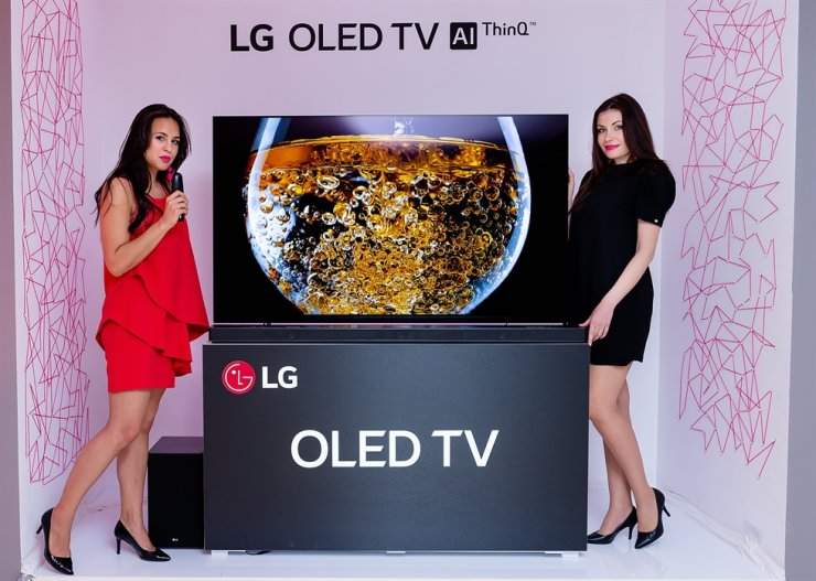 Models introduce LG OLED TV during LG Electronics' new product showcase in Warsaw, Poland, in April 2018. Courtesy of LG Electronics