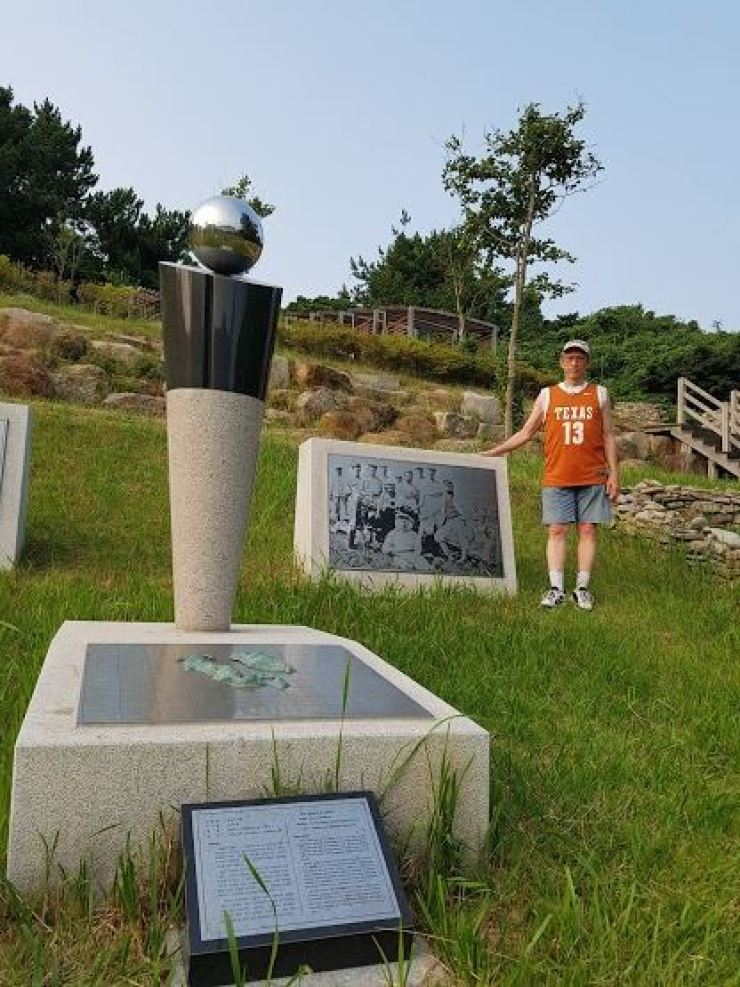 Richard Pennington stands at the cemetery for British sailors, who illegally occupied Geomundo Island from 1885 to 1887, in this July 2018 photo. Courtesy of Richard Pennington