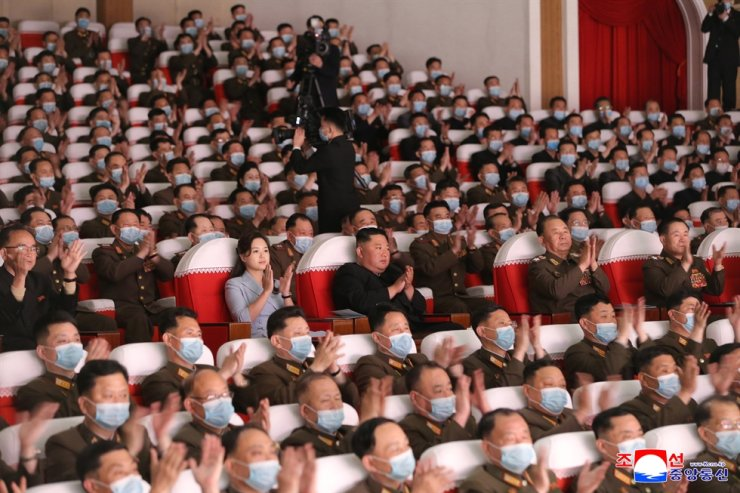 A photo released by the official North Korean Central News Agency on May 6 shows North Korean leader Kim Jong-un, center, and his wife Ri Sol-ju watch a performance given by the art groups of servicemen's families in Pyongyang, North Korea, May 5. The World Health Organization said Tuesday that North Korea has not found any COVID-19 cases. EPA-Yonhap