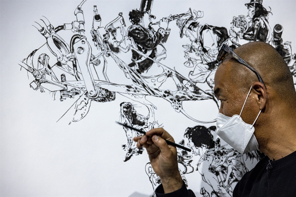 Visual artist Kim Jung-gi poses in the hall of his solo exhibition, 'Kim Junggi, The Other Side,' at the Lotte Museum of Art (LMOA) in Seoul, May 3. Korea Times photo by Shim Hyun-chul