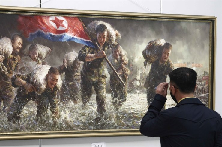 A visitor views a dramatic nationalist painting at the National New Fine Art Talents Exhibition at the Okryu Exhibition Hall in Pyongyang, North Korea, May 11. AP-Yonhap