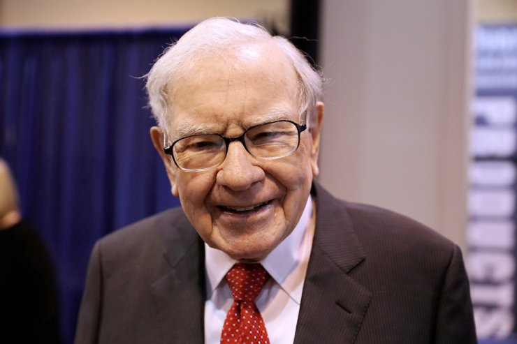 In this May 4, 2019, file photo, Berkshire Hathaway Chairman Warren Buffett walks through the exhibit hall as shareholders gather to hear from the billionaire investor at Berkshire Hathaway Inc's annual shareholder meeting in Omaha, Nebraska. On Saturday, Buffett warned people not to think investing is an easy way to make a fortune as he answered questions at Berkshire Hathaway's annual meeting. Reuters