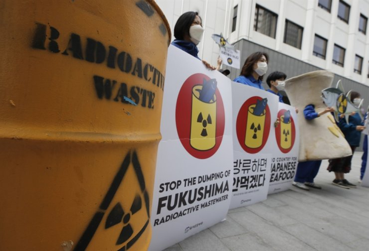 Members of environmental groups attend a rally against Japanese government's decision to release treated radioactive water from the Fukushima nuclear power plant damaged in the 2011 earthquake and tsunami, in Seoul, Wednesday. AP-Yonhap