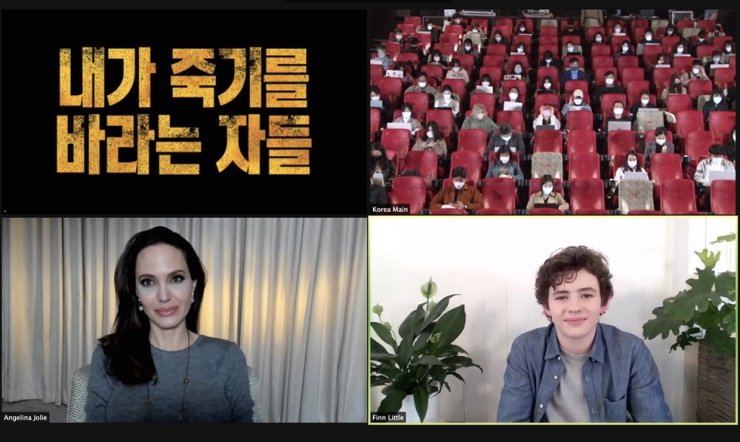 Actors Angelina Jolie, bottom left, and Finn Little, bottom right, talk during an online press conference for 'Those Who Wish Me Dead,' Tuesday. Courtesy of Warner Bros. Korea