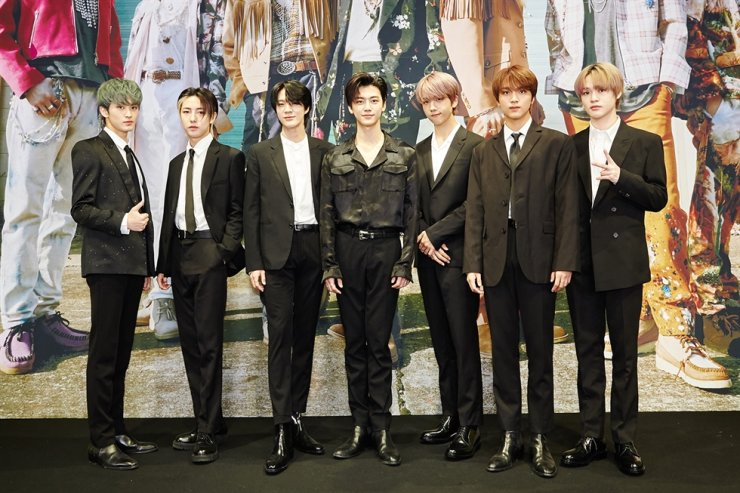 Members of K-pop boy group NCT DREAM pose for photos during an online media conference, Monday. Courtesy of SM Entertainment