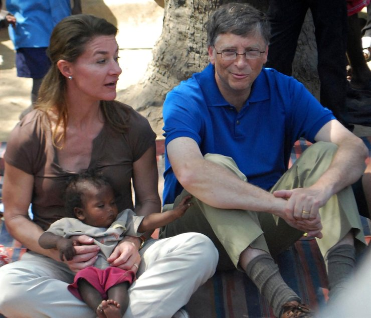 In this file photo taken on March 23, 2011, Microsoft founder and philanthopist Bill Gates looks on as his wife Melinda holds a toddler during their visit to a village at Patna district in India's Bihar's state. AFP-Yonhap