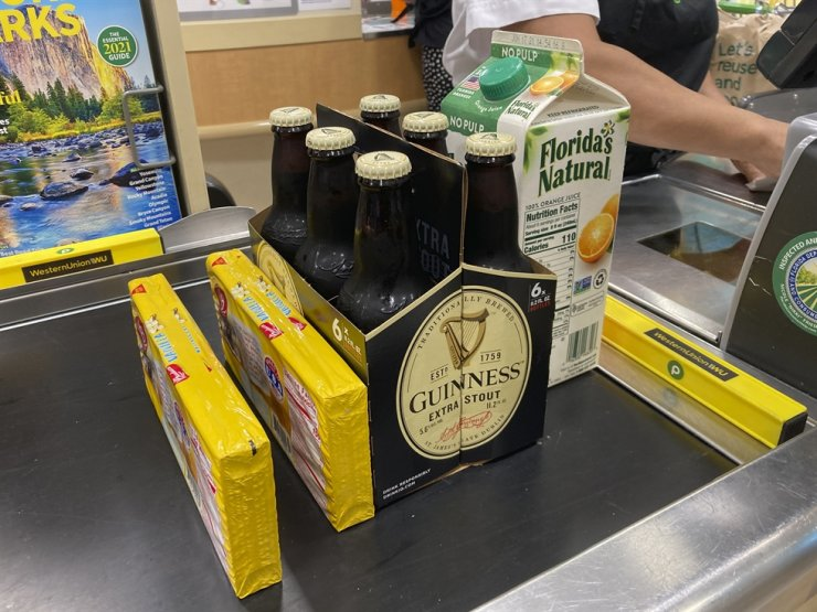 Groceries are shown at a checkout counter at a grocery store in Surfside, Fla., April 16. AP-Yonhap