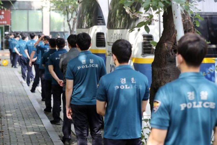 In this August 2020 file photo, Korean auxiliary police members line up for COVID-19 testing. Yonhap