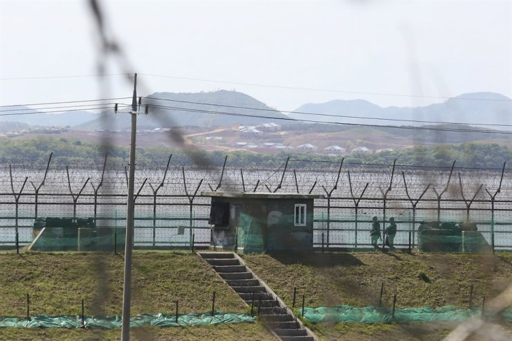 South Korean soldiers patrol along the barbed-wire fence in Paju, South Korea, near the border with North Korea, May 2. North Korea has expressed its intention not to participate in Asian qualifiers for the 2022 Qatar World Cup, set to take place in South Korea next month, a football governing body in South Korea said Monday. AP-Yonhap