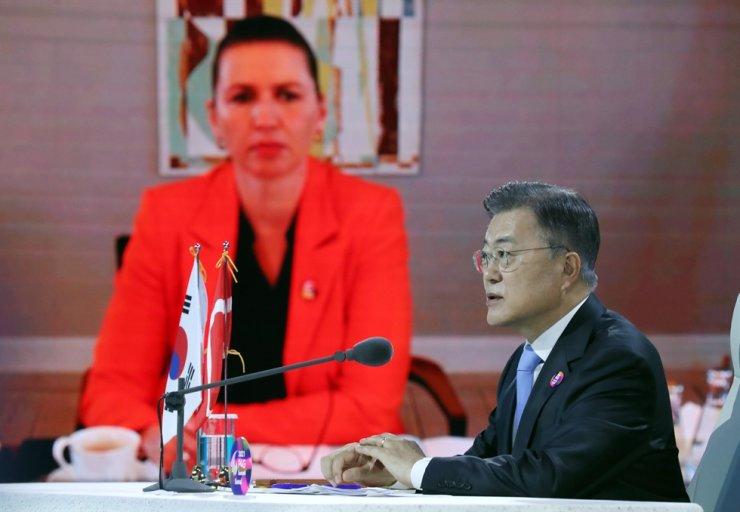 President Moon Jae-in speaks during virtual summit talks with Danish Prime Minister Mette Frederiksen, May 30. Yonhap