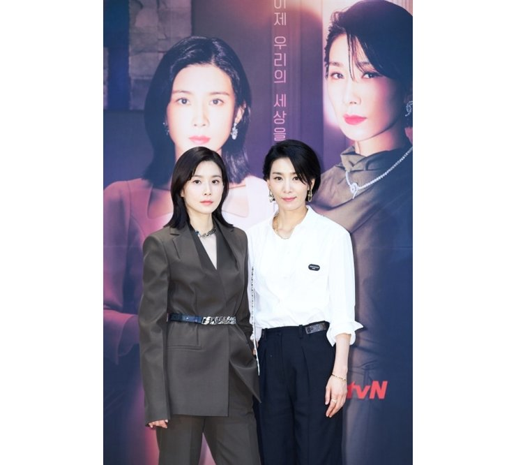 Actresses Lee Bo-young, left, and Kim Seo-hyung pose for pictures during the media conference for tvN's new series 'Mine,' Friday. Courtesy of tvN