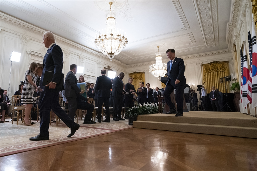 Figure1President Moon Jae-in speaks as U.S. President Joe Biden listens during a joint news conference in the East Room of the White House, Washington, D.C., Friday (local time). AP-Yonhap