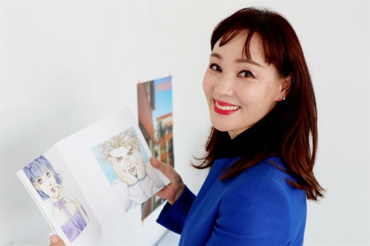Comic artist Won Soo-yeon poses during an interview in Seoul, Thursday. Courtesy of Rockin' Korea