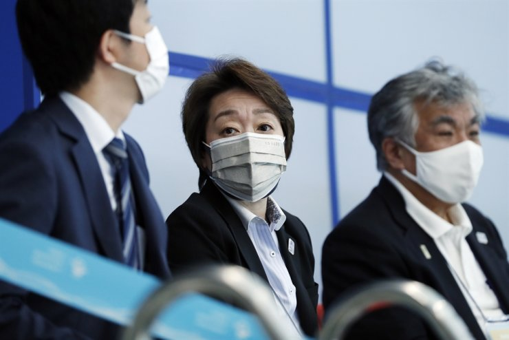 Tokyo 2020 Olympic Games President Seiko Hashimoto, center, watches an aquatics test event in the stands at Tokyo Aquatics Centre, Tokyo, May 1. Six people who helped the international sporting event have tested positive for COVID-19, organizers said Saturday. Reuters