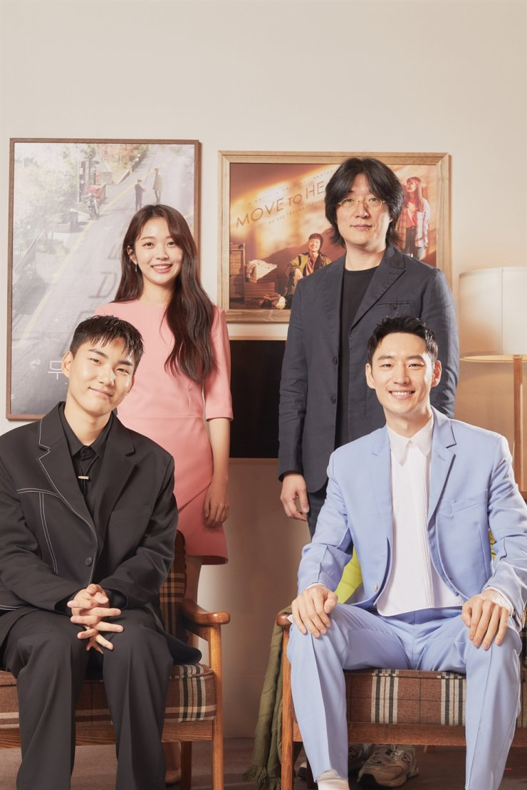 From top left, clockwise, actress Hong Seung-hee, director Kim Sung-ho, and actors Lee Jae-hoon and Tang Jun-sang pose for pictures during an online media event for 'Move to Heaven,' Wednesday. Courtesy of Netflix