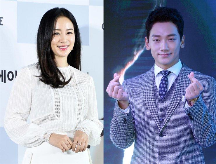 From left, Kim Tae-hee and her husband Rain / Korea Times file