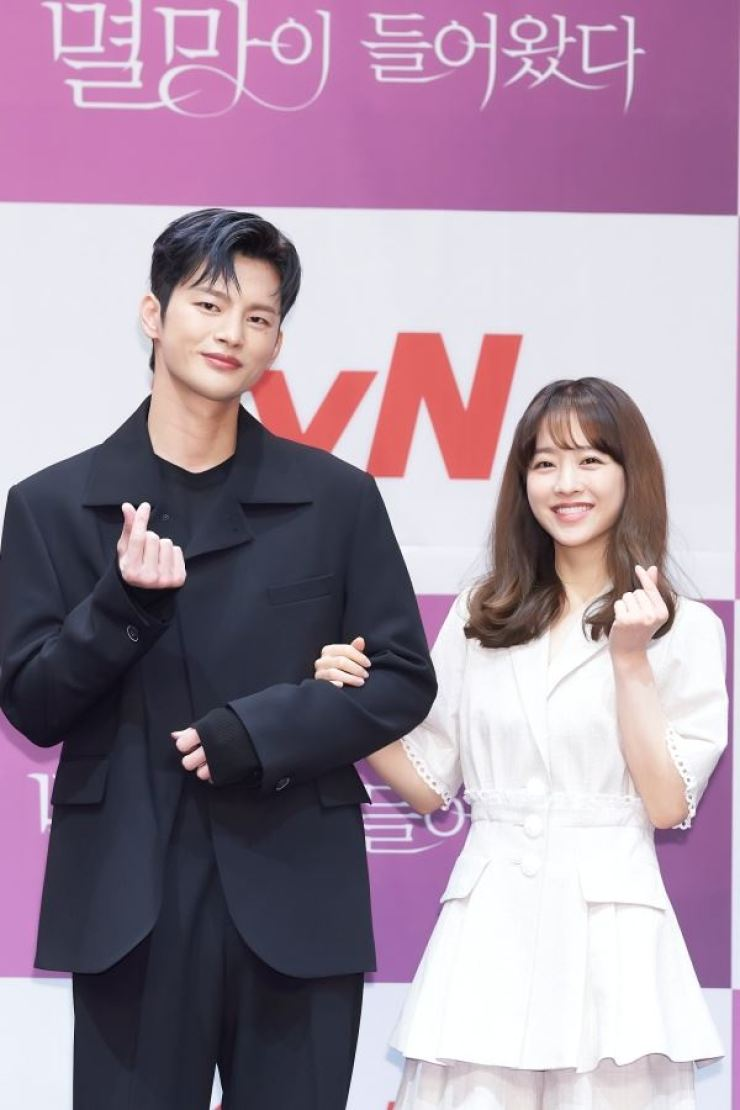 Actors Seo In-guk, left, and Park Bo-young pose for pictures during the online media conference for the series, 'Doom at Your Service,' Thursday. Courtesy of tvN