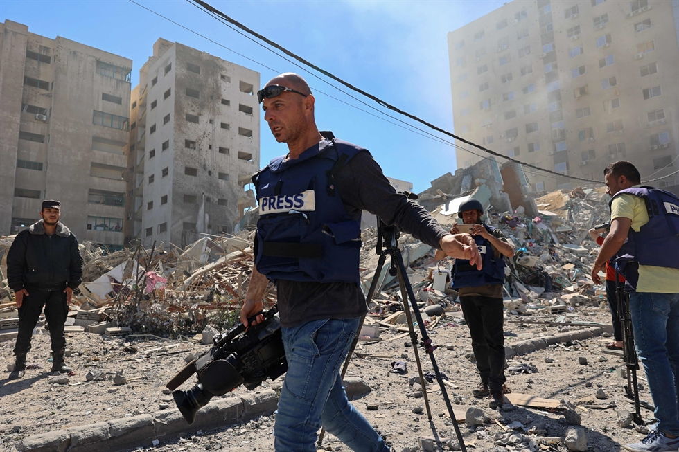 The building housing the offices of The Associated Press and other media in Gaza City collapses after it was hit by an Israeli airstrike Saturday, May 15, 2021. AP-Yonhap
