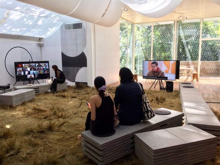 The Curators Collective meeting held on Zoom, May 23, is seen on a television monitor at the Korean pavilion at the 17th Venice Architecture Biennale. Courtesy of Korean pavilion's Venetian team