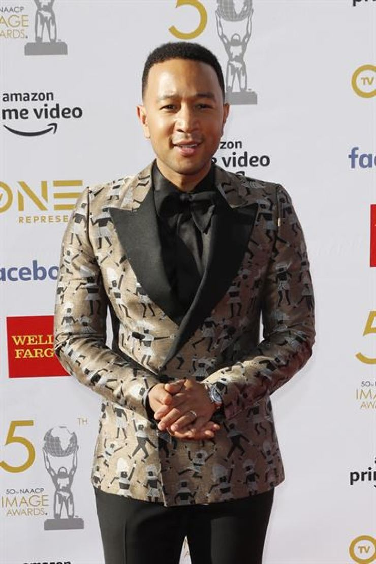 U.S. singer John Legend poses for the photographers upon arrival for the 50th NAACP Image Awards at the Dolby Theatre in Hollywood, California, USA, March 30, 2019 (issued 31 March 2019). EPA-Yonhap