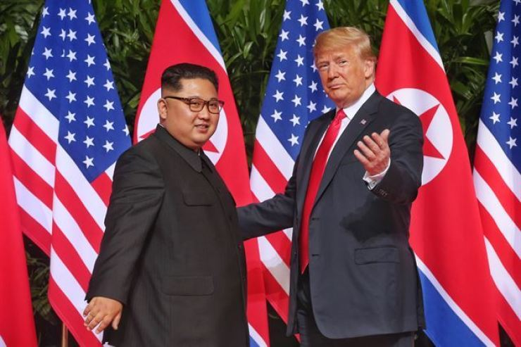 Then-President Donald Trump and North Korean leader Kim Jong-un pose during their summit in Singapore in this June 12, 2018 photo. Yonhap