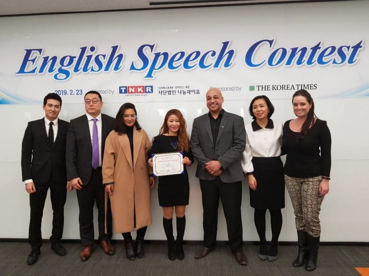 In this February, 2019, file photo, Park Eun-hee, center, poses after winning a prize in the English Speech Contest for North Korean defectors in South Korea, at Shin and Kim Law Office in Seoul. Courtesy of Voices from the North