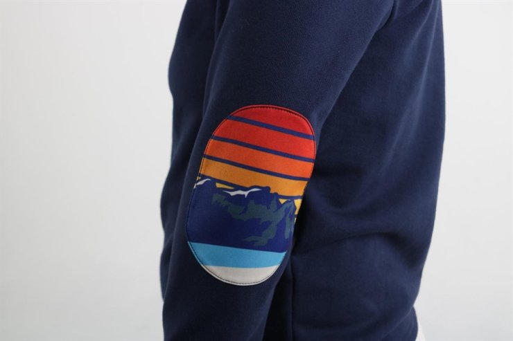 ISTORY's elbow-patch shirt inspired by Kang's life-changing sighting of a foreign tourist at Mount Paektu in North Korea / Courtesy of ISTORY