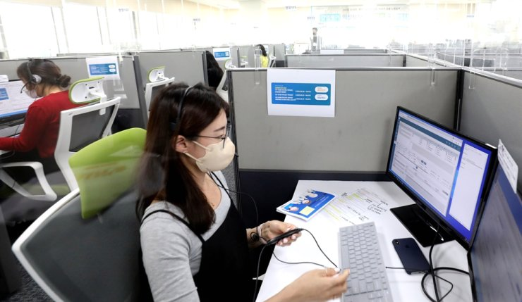 On May 6, when COVID-19 vaccination for people aged 70-74 began in Korea, a call center employee in Seoul's Yeongdeungpo District answers a caller who wants to reserve a dose of vaccine. Yonhap