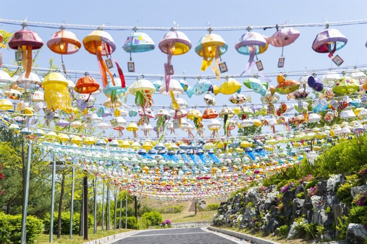 Jellyfish-shaped lanterns sway in the wind at