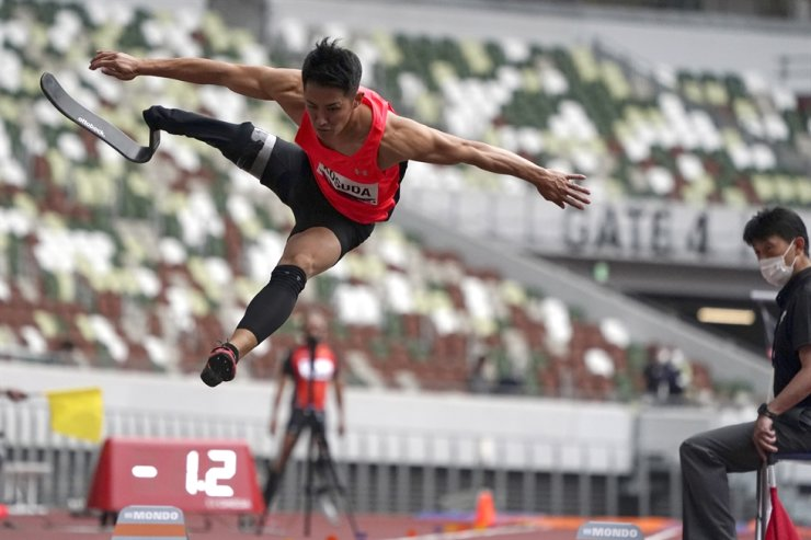 Japanese Junta Kosuda competes in the men's long jump during an athletics test event for the Tokyo 2020 Paralympics Games at National Stadium in Tokyo, May 11. Japan is gearing up to offer COVID-19 vaccinations to around 2,500 Olympic and Paralympic athletes and support staff, using shots donated for the Games. AP-Yonhap