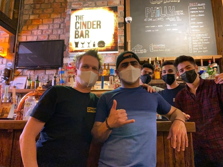 Warren Kidd, left, and the staff of The Cinder Bar in Incheon's Songdo International City, May 22. / Courtesy of The Cinder Bar